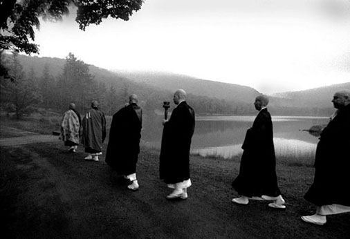 DBZ01-JULY1999-Near Livingston Manor, NY:  Ven.  Eido T. Shimano Roshi,  Abbot of the Zen Monastery Dai Bosatsu Zendo, leads monks past Beecher Lake during the  Anniversary Sesshin in July 1999.  Sesshins are  week-long intensive Zen silent retreats held at Dai Bosatsu Zendo six times a year, during which zazen, or Zen meditation,  is emphasized.
