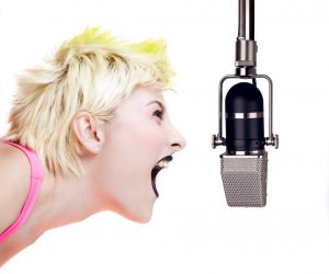 Punk Girl Shouting at the Microphone